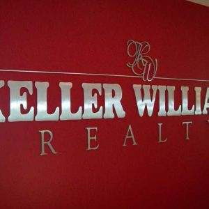 brushed metal wall sign